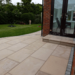 Patio in Southampton created using Marshalls Versuro (Golden Sand Multi) and edged with Marshalls Sawn and Tumbled Sandstone Setts (Silver Birch)